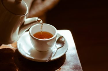 Image of a pot of tea being poured into a tea cup