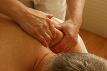 a man undergoing shoulder massage