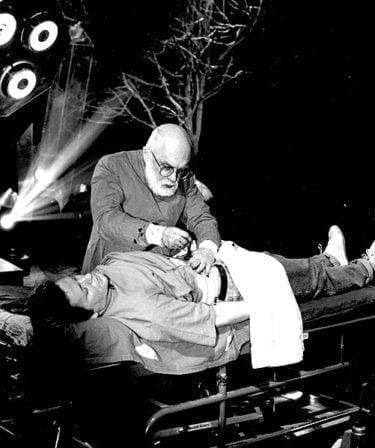 "James Randi demonstrating 'psychic surgery' on ITV series ""James Randi, Psychic Investigator""  Credit: https://commons.wikimedia.org/wiki/File:James_Randi_demonstrating_%27psychic_surgery%27_on_ITV_series_%22James_Randi,_Psychic_Investigator%22.jpg"