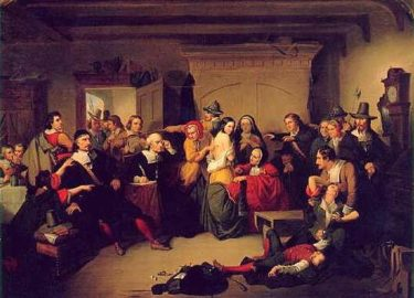 Examination of a Witch by T. H. Matteson. A painting depicting a trial in which many are pointing and shouting while a woman is collapsed into the arms of a man, another man passed out at her feet.