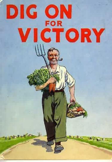 "A drawing of a man carrying various vegetables and a garden fork walks in front of a blue sky with the words ""Dig on for Victory"" written in large red writing above."