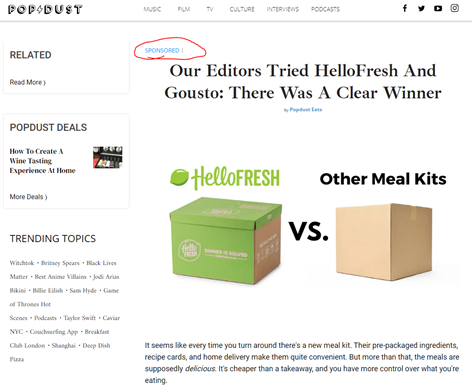 "The PopDust website with the article headlined ""Our Editors Tried HelloFresh and Gousto: There was a Clear Winner"". The article is listed ""Sponsored"" and the image shows a HelloFresh box next to a plain brown box labelled ""Other Meal Kits""."