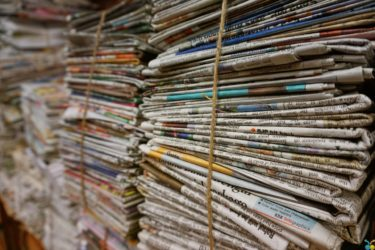 A stack of newspapers tied with string