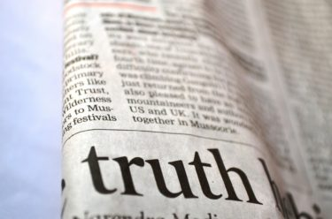 A newspaper with the word Truth