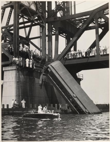 The last carriage of the commuter train dangling from the Newark Bay lift bridge in 1958