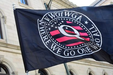 "A Qanon flag at a rally in Virginia with the tag line ""Where We Go One We Go All"". Image by Anthony Crider (CC-by-2.0)"