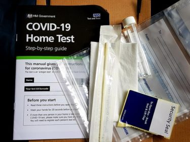 A COVID Home Test Kit from the UK Government and the NHS. The kit contains a sterile swab, a plastic sample bag, a labelled tube with a lid to put the swab inside and an instruction booklet. [CC-by-SA-4.0] image by Wikimedia user Fae.