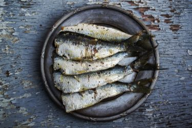A plate of cooked sardines