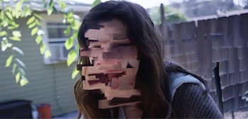 A shot from the trailer of the film. A girlf with a distorted face