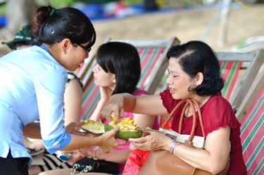 Women sharing fruit together